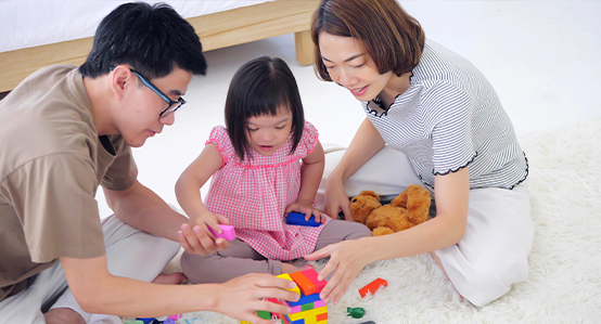 Parents playing with daughter